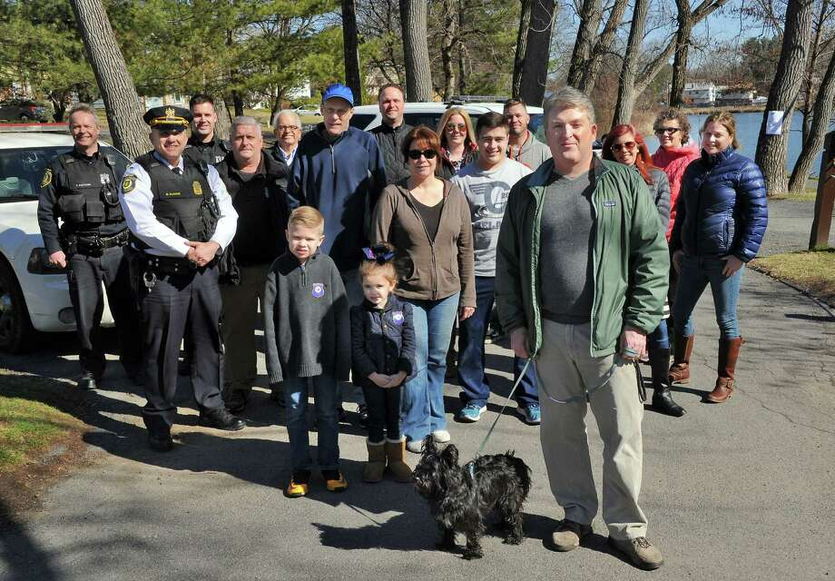 Board president Daniel Sleasman, center with his terrier Finn, members of the new Buckingham Lake Neighborhood Association and APD's community police team 3 pose for a photo at Buckingham Lake Park Saturday March 19, 2016 in Albany, NY.  (John Carl D'Annibale / Times Union) ORG XMIT: MER2016031920194151 Photo: John Carl D'Annibale / 10035871A