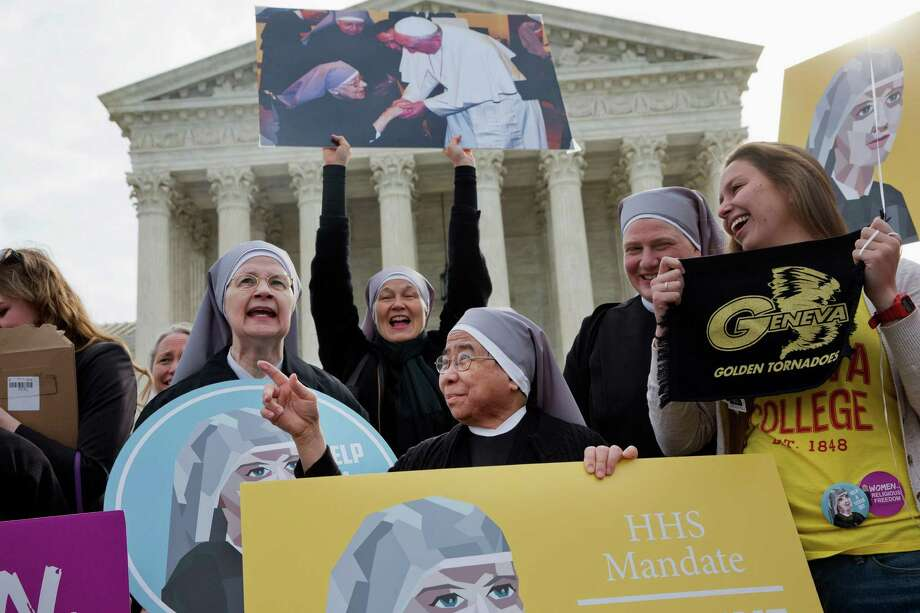 Nuns with the Little Sisters of The Poor, including Sister Celestine, left, and Sister Jeanne Veronique, center, rally outside the Supreme Court in Washington, Wednesday, March 23, 2016. Photo: Jacquelyn Martin / AP