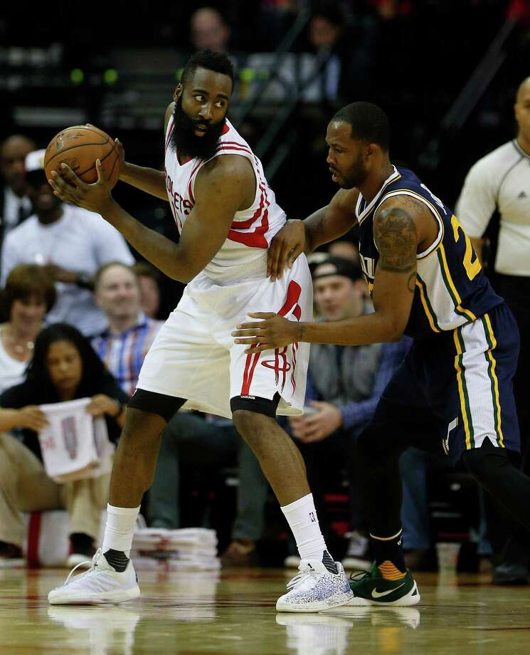 Rockets guard James Harden (left) cited his own late-game turnovers in recent losses as a way the Rockets could execute better down the stretch. Photo: Karen Warren, Houston Chronicle / © 2016  Houston Chronicle