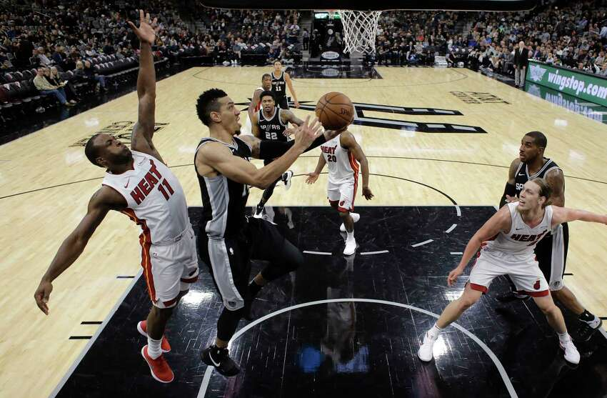 Miami Heat center Kelly Olynyk (9) drives to the basket against San Antonio Spurs forward Davis Bertans (42) during the first half of an NBA basketball game Wednesday, Dec. 6, 2017, in San Antonio. (AP Photo/Eric Gay)