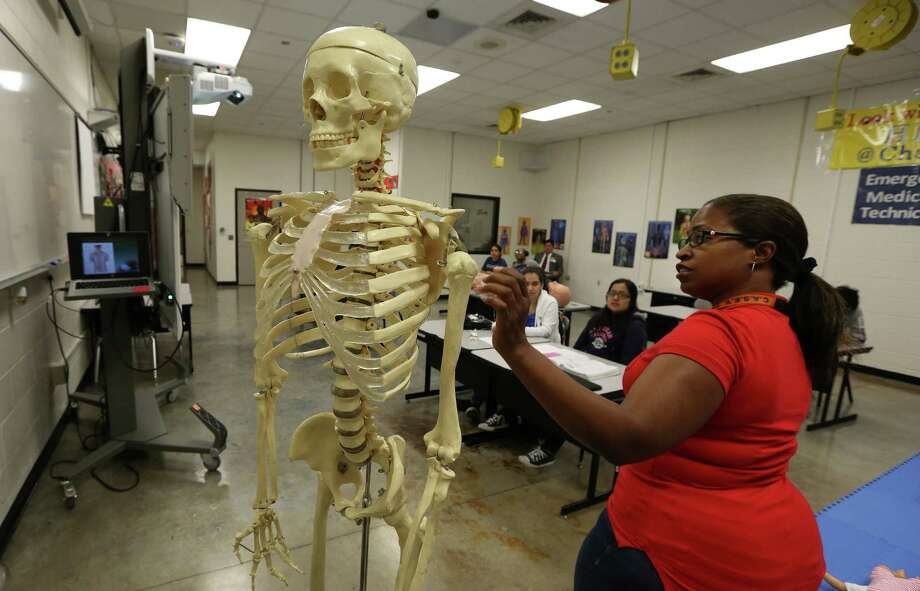 Nefertari Alexander teaches a new EMT class that allows Chavez High School students to get high school and college credit through Lone Star College. Photo: Steve Gonzales / © 2016 Houston Chronicle