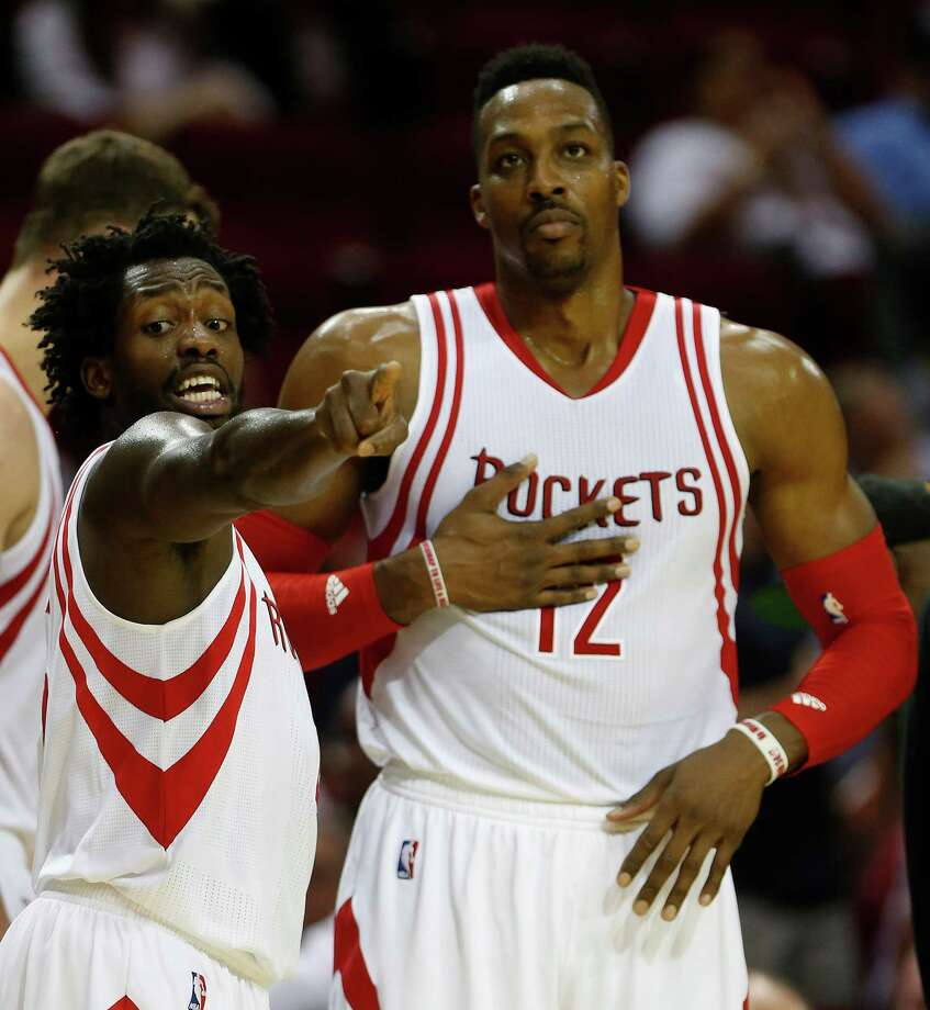 Houston Rockets guard Patrick Beverley (2) talks with center Dwight Howard (12) during the second half of an NBA basketball game at Toyota Center, Wednesday, March 23, 2016. Photo: Karen Warren, Houston Chronicle / © 2016  Houston Chronicle