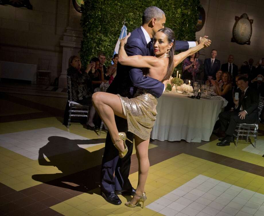 Warming relations: At the March 23 state dinner in Buenos Aires, Barack Obama danced a tango. Photo: Pablo Martinez Monsivais, AP