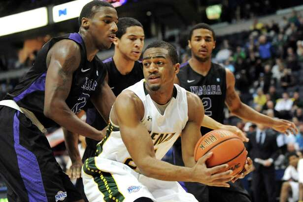 Siena's Jimmy Paige, center, protects the ball as he looks to pass during their first round game against Niagara in the MAAC Championship on Thursday, March 5, 2015, at Times Union Center in Albany, N.Y. (Cindy Schultz / Times Union)
