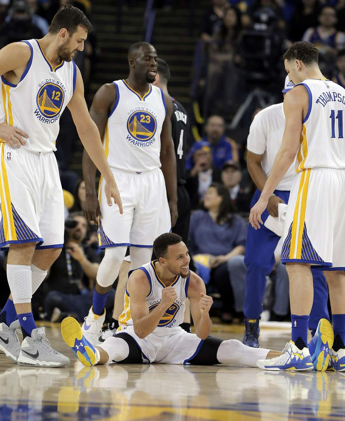 Stephen Curry (30) reacts to being called for a foul after getting knocked down in the first half as the Golden State Warriors played the Los Angeles Clippers at Oracle Arena in Oakland, Calif., on Wednesday, March 23, 2016.