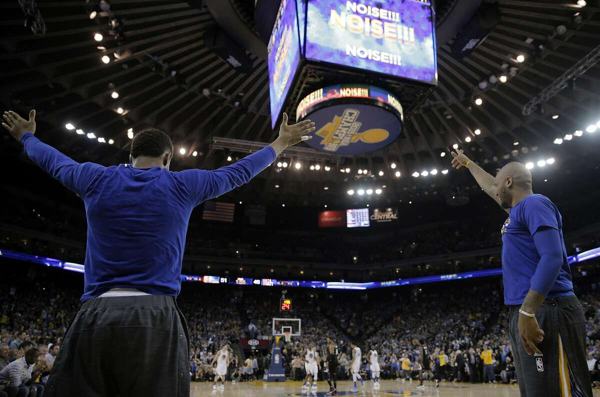 Leandro Barbosa, left, and Marreese Speights, right, celebrate a three point shot in the first half as the Golden State Warriors played the Los Angeles Clippers at Oracle Arena in Oakland, Calif., on Wednesday, March 23, 2016.
