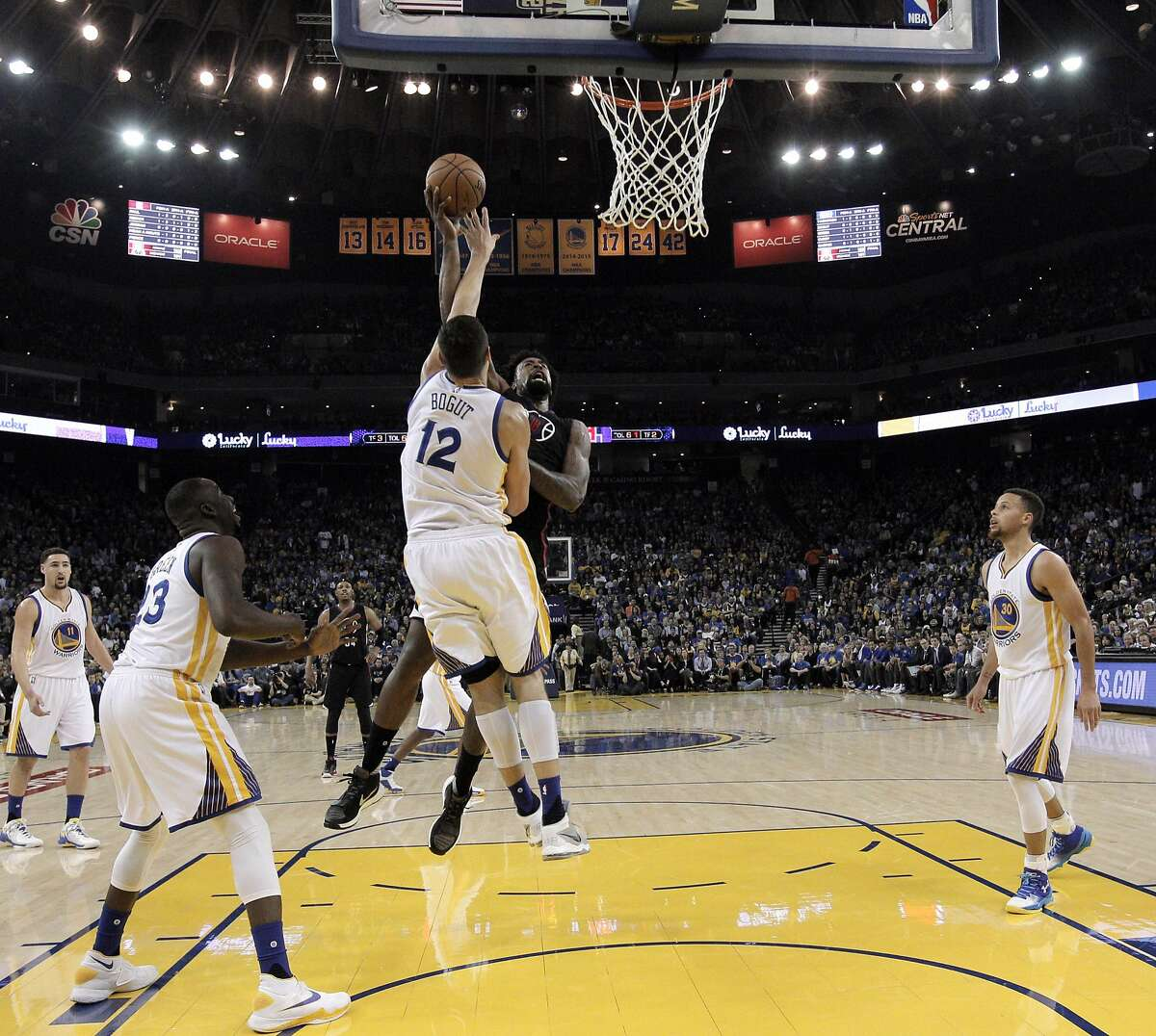 Deandre Jordan (6) puts a shot up over Andrew Bogut (12) in the first half as the Golden State Warriors played the Los Angeles Clippers at Oracle Arena in Oakland, Calif., on Wednesday, March 23, 2016.