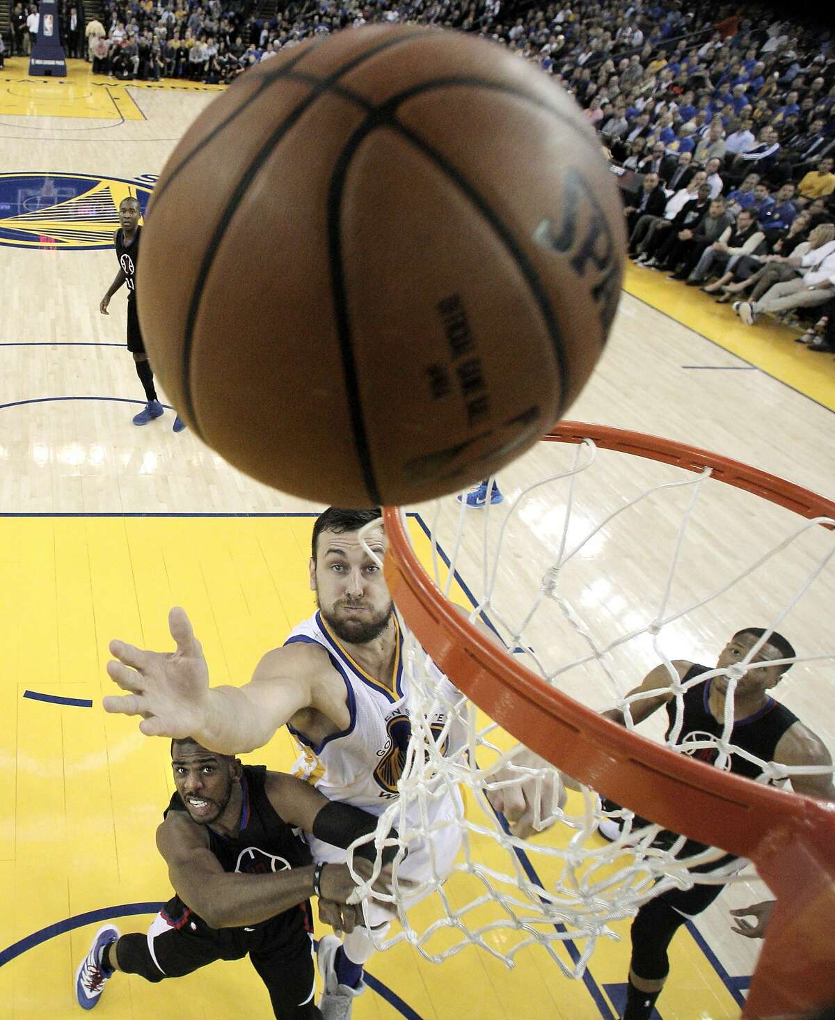 Chris Paul (3) tries to block out Andrew Bogut (12) from a rebound in the first half as the Golden State Warriors played the Los Angeles Clippers at Oracle Arena in Oakland, Calif., on Wednesday, March 23, 2016.