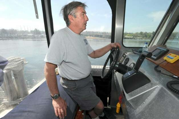 Frank Rupp, of the Greenwich marine and facilities operations, boating along the Greenwich harbor, on Thursday, April 8, 2010. Photo: Helen Neafsey / Greenwich Time