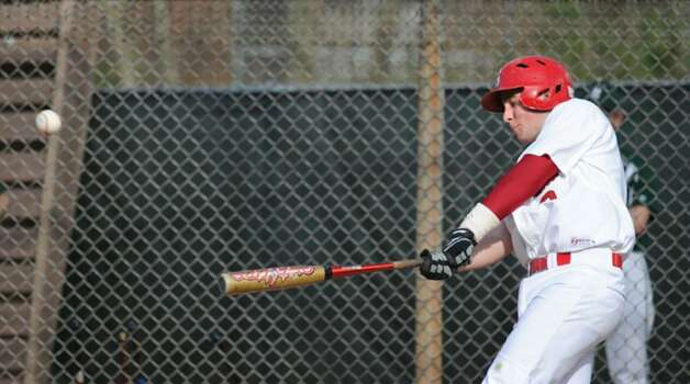 Kevin Collins of GHS drives in 2 runs as he hits a single in the bottom of the 3rd inning off of Norwalk pitcher, Jonathan Cohen, Wednesday, April 7, 2010. Photo: Bob Luckey / Greenwich Time
