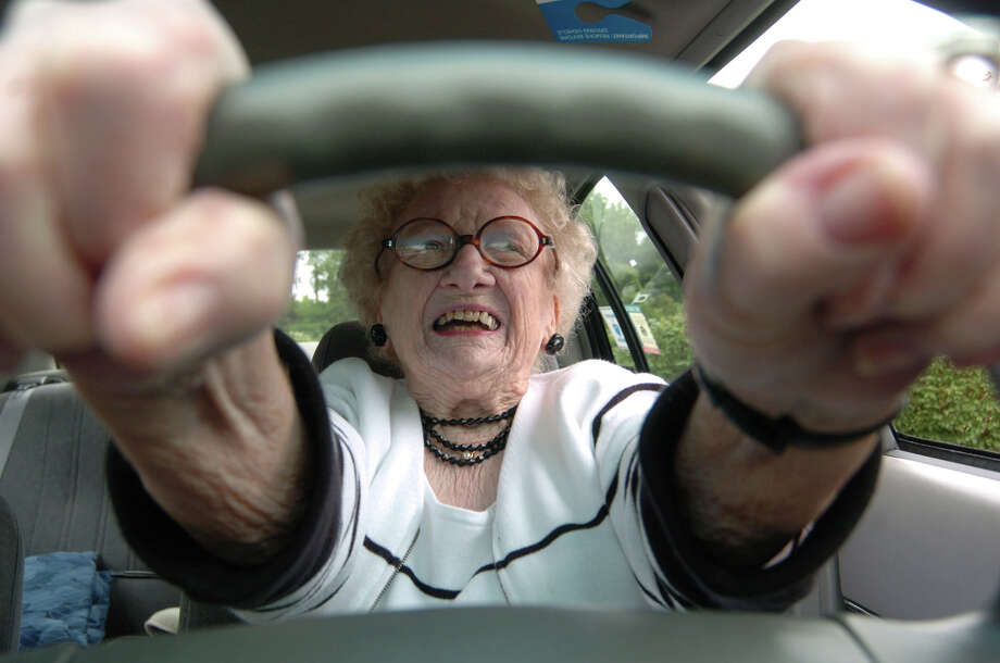 Dorothy Wulfers, 87, who learned to drive a Model T Ford at age 15, prepares to pull out of her parking space in Morgantown, W.Va. A new study by AAA finds drivers who often falll are 40 percent more likely to have traffic accidents. Fractured wrists or broken legs, healed over time, could make braking or steering difficult; while poor balance, slow reaction time, and vision problems weakens a driver's ability to avoid crashes. More important, however, is a driver's fear of falling can also lead to decreased physical activity that diminishes basic driving skills and shakes driving confidence. Photo: DALE SPARKS / AP / AP
