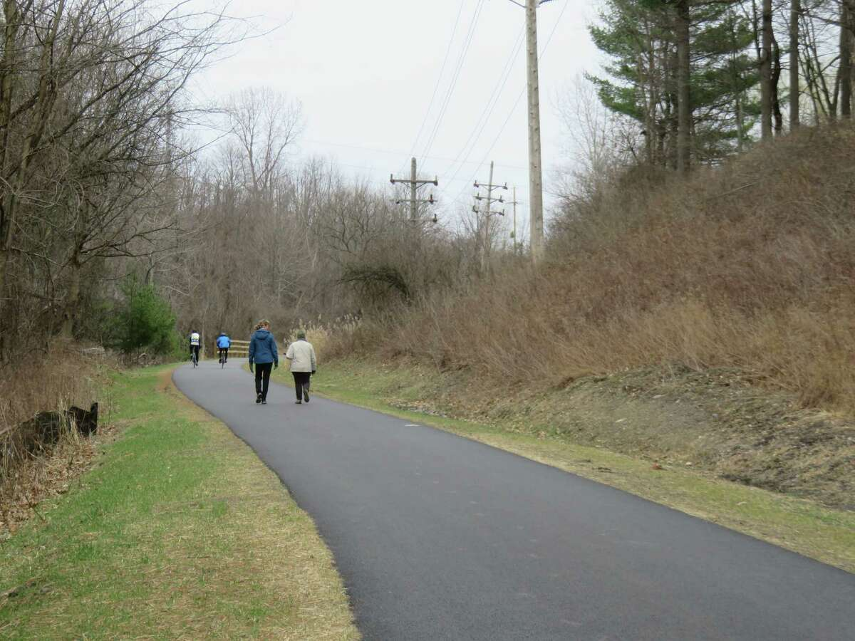 Walkers, runners and cyclists were all out on the Albany County Helderberg Hudson Rail Trail last weekend. The trail is now paved from South Pearl Street in Albany to the Bethlehem Veterans Memorial Park. (Gillian Scott / Special to the Times Union)