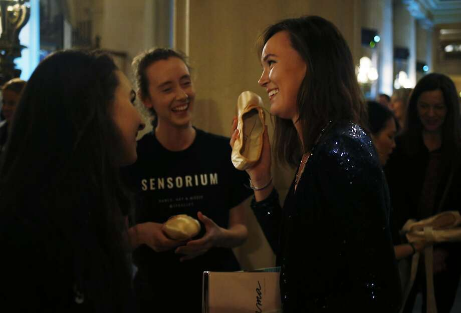 Emma Powers (right) jokes around with a pointe shoe as dancers Samantha Bristow (left) and Maggie Weirich laugh during Sensorium. Photo: Connor Radnovich, The Chronicle