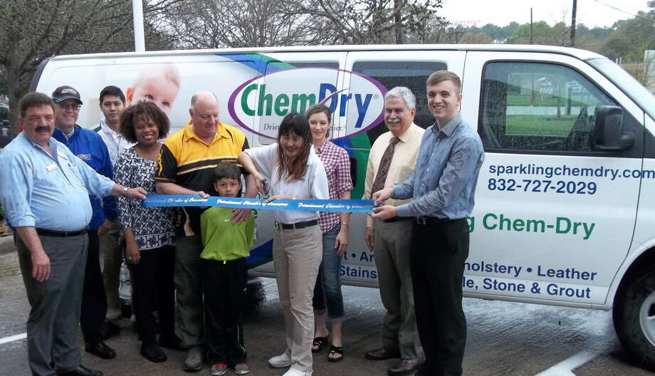 Dary VanWoerkom, owner of Sparkling Chem Dry, cuts a ribbon celebrating her membership in the Friendswood Chamber of Commerce March 8. Members of the business networking organization welcomed VanWoerkom to the chamber.