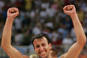 MEN'S BASKETBALL - Emanuel David Ginobili celebrates after their men's basketball semi-final victory against the U.S. at the Athens 2004 Olympic Games, August 27, 2004. Argentina won the game 89-81.  REUTERS/Lucy Nicholson.  HOUCHRON CAPTION:  (08/28/2004) SECSPECIAL :  WHAT A FEELING: The look on Manu Ginobili's face says it all after he and his Argentine teammates defeated the United States 89-81.  SPECIAL SECTION: ATHENS 2004.