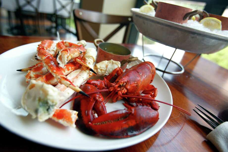 Maine lobster and King crab legs Photo: William Luther /San Antonio Express-News / © 2014 San Antonio Express-News