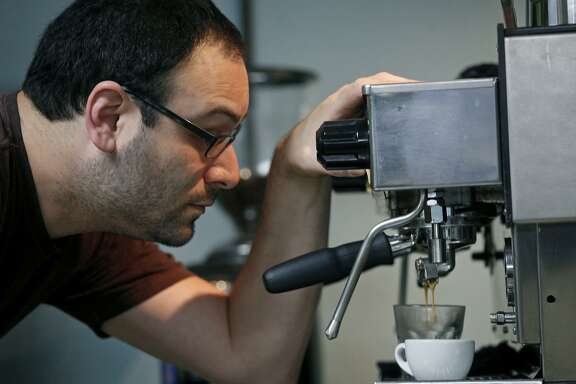 Aaron Blanco, owner of The Brown Coffee Co., makes a Cortave for a customer.