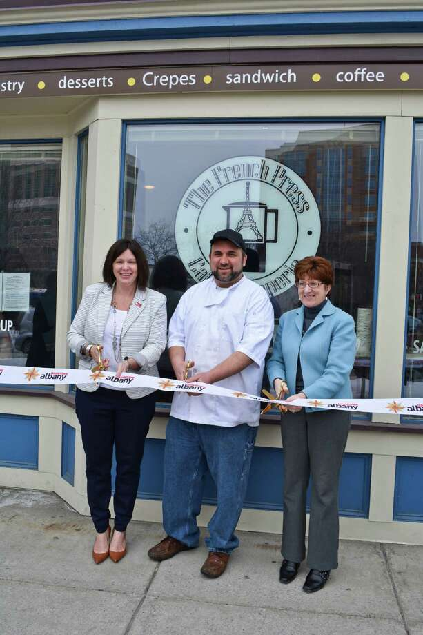 The grand opening of The French Press Café & Creperie at 5 Clinton Square on Thursday, February 26, 2015, with Downtown Albany BID executive director Georgette Steffens, owner Morgan Pellitteri, and Albany Mayor Kathy M. Sheehan. (Courtesy Downtown Albany BID)
