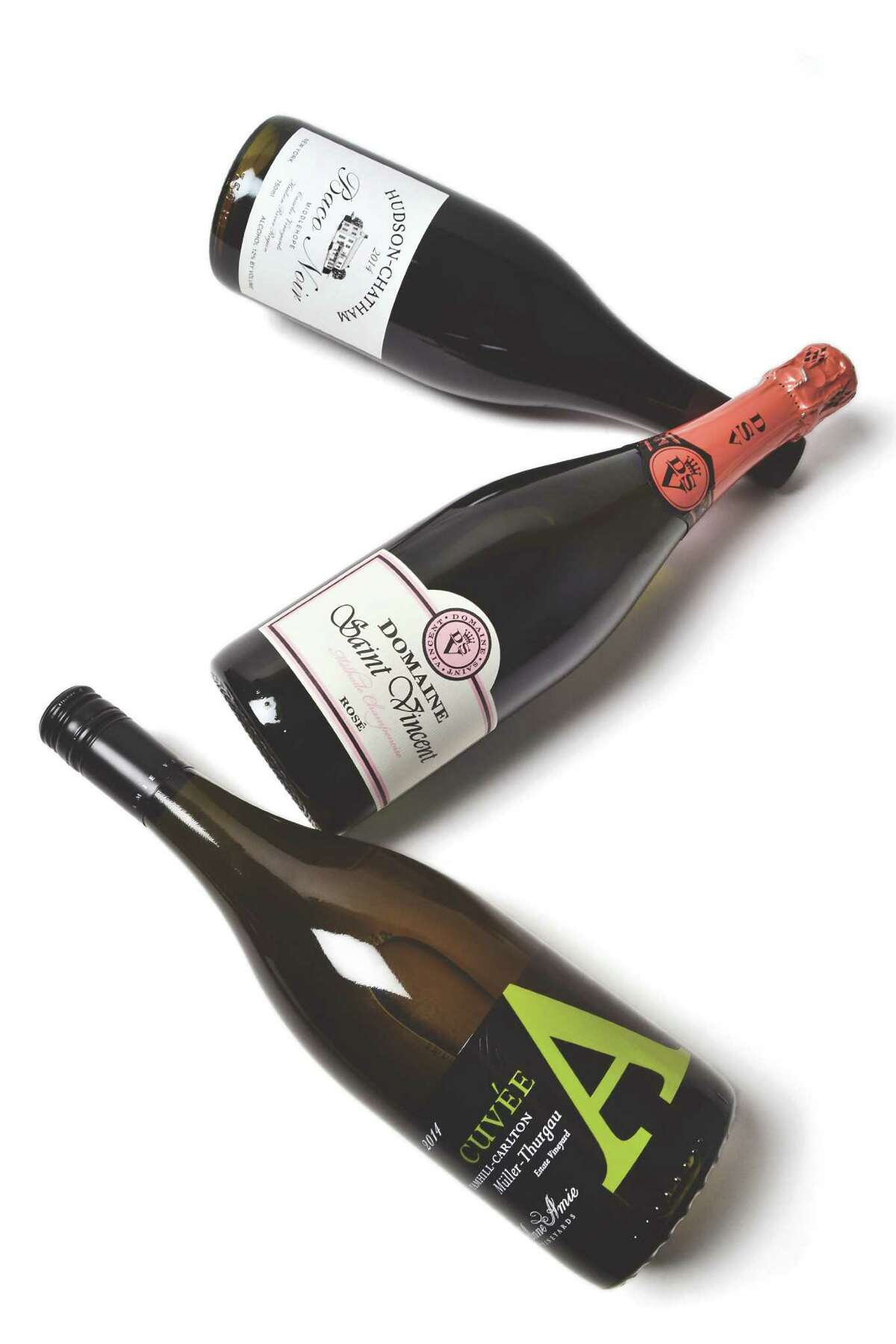 A selection of wines for April from Mark Brogna of Capital Wine in Albany. From top, Baco Noir Middle Hope Vineyard (2014) $23.99, Domaine Saint ?Vincent Rose $12.99, Baco Noir Middle Hope Vineyard (2014) $23.99 (Colleen Ingerto / Times Union)