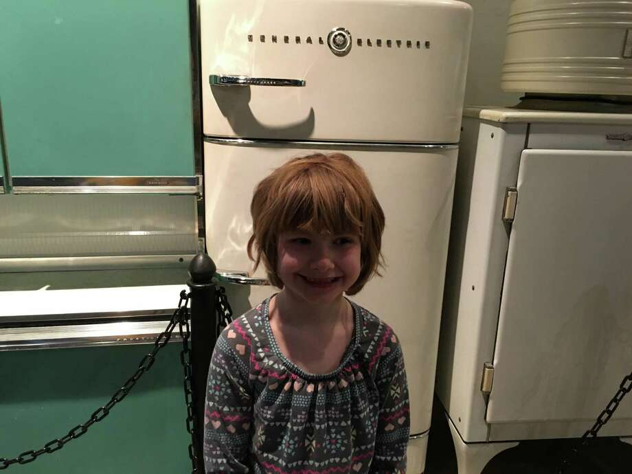 What kid doesn't love antique refrigerators? Budding foodie Matilda sure does! (Jennifer Gish / Times Union)