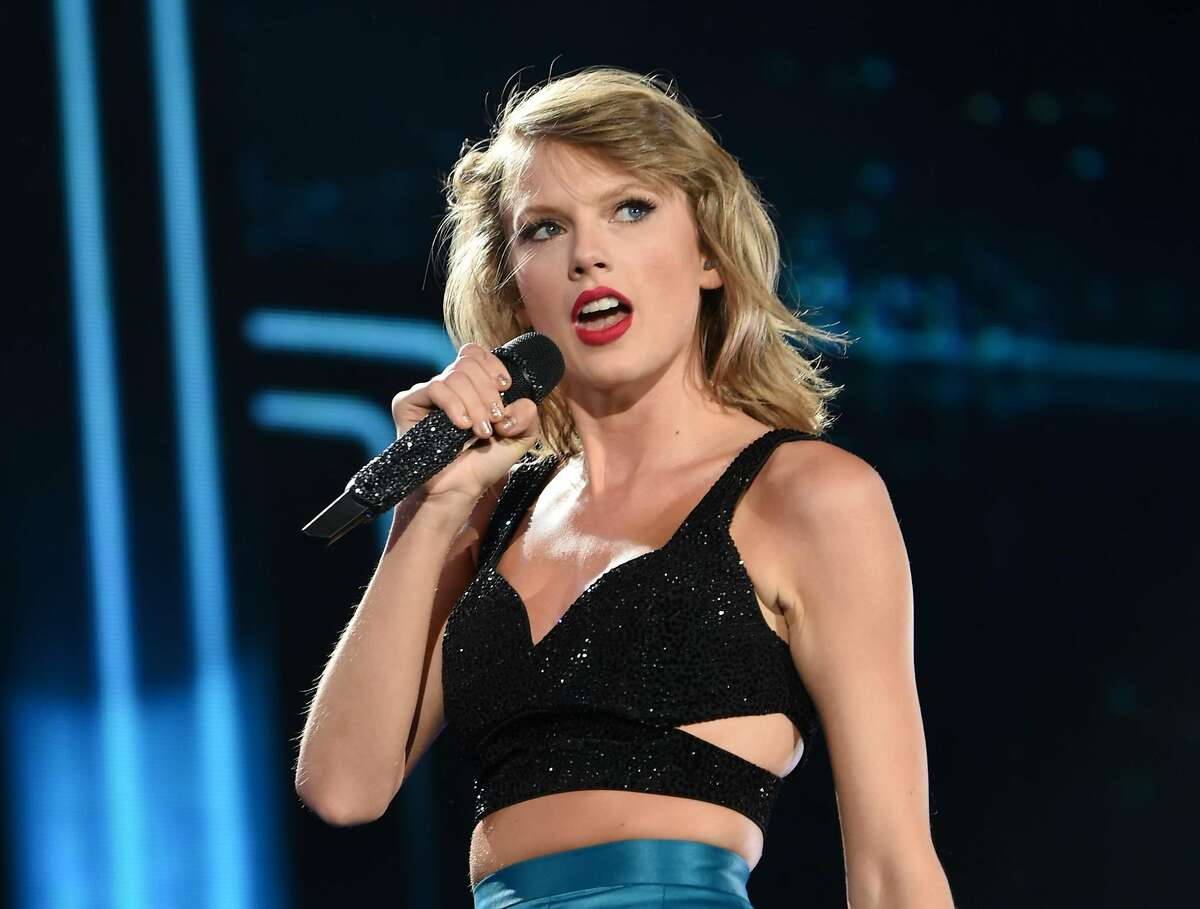 """FILE - In this July 10, 2015 file photo, singer Taylor Swift performs during her """"1989"""" world tour at MetLife Stadium in East Rutherford, N.J. Swift will open the 58th annual Grammy Awards with a performance from her nominated album, �1989."""" She is one of the year�s top nominees with seven nominations, including album of the year, record of the year and song of the year. (Photo by Evan Agostini/Invision/AP, File)"""