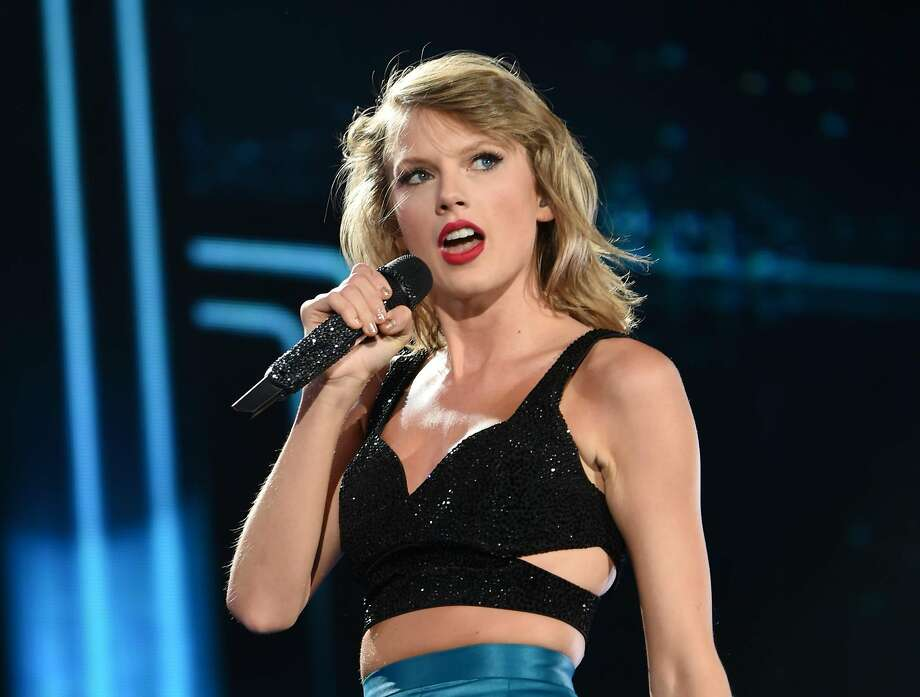 """Singer Taylor Swift, seen here performing during her """"1989"""" world tour at in East Rutherford, N.J., has some time-honored wisdom for dealing with haters in her smash hit """"Shake It Off."""" Photo: Evan Agostini, Associated Press"""
