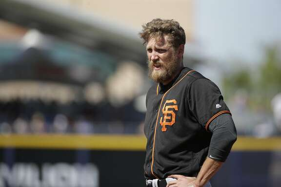 San Francisco Giants' Hunter Pence stands on the field during a spring training baseball game against the Seattle Mariners Wednesday, March 16, 2016, in Peoria, Ariz. (AP Photo/Jae C. Hong)