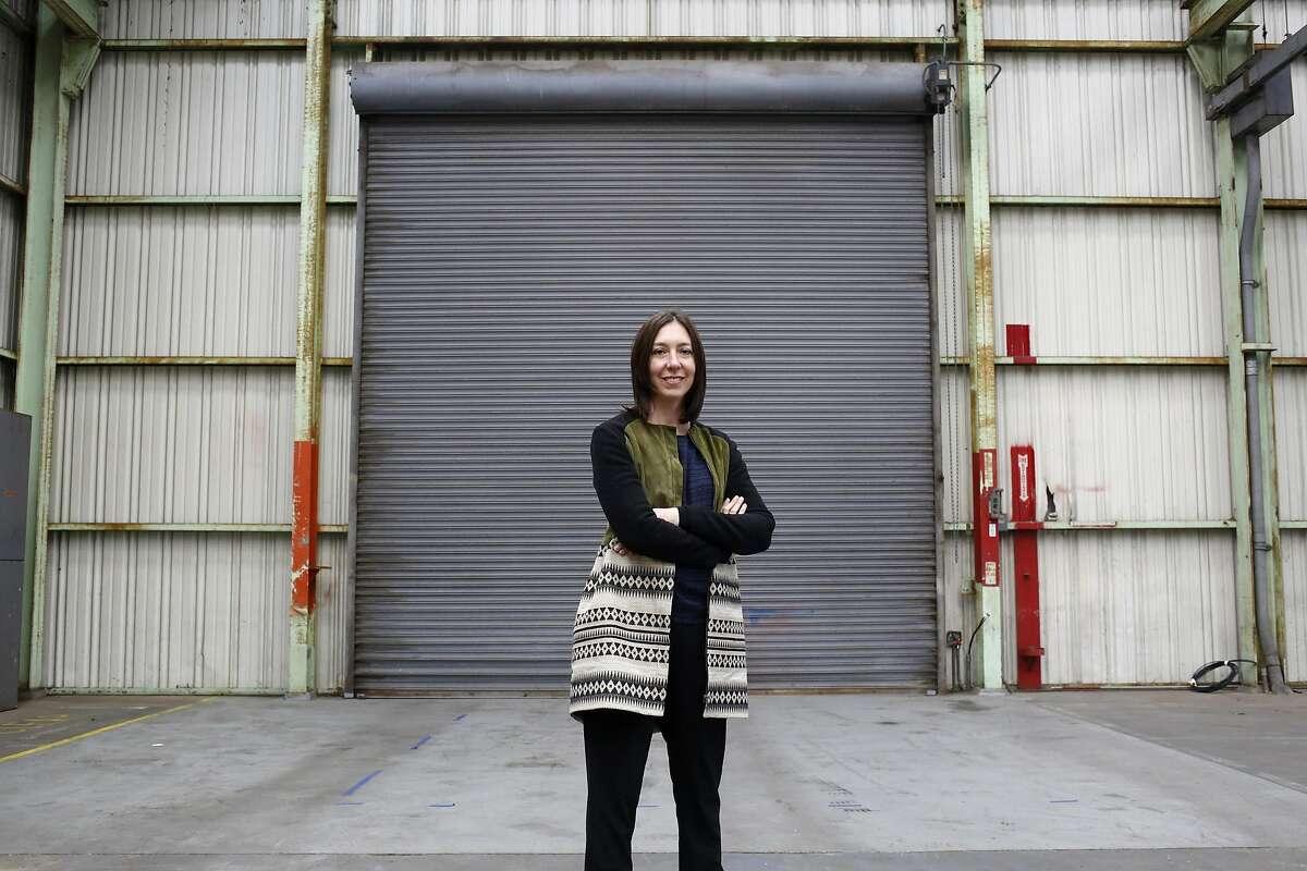 Claudia Altman-Siegel poses for a photograph in the large warehouse that will host her new gallery in the Dogpatch neighborhood of San Francisco, California, on Wednesday, March 23, 2016.