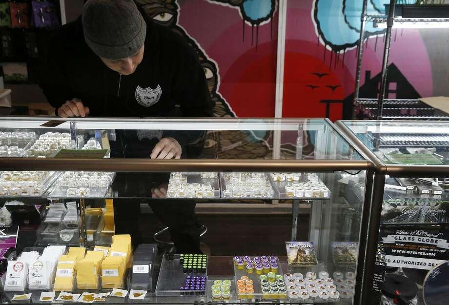 Ari Leones works behind the hash bar at Blum Oakland, a downtown medical marijuana dispensary. Photo: Leah Millis, The Chronicle