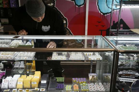 Ari Leones works behind the hash bar at Blum Oakland, a medical marijuana dispensary, March 24, 2016 in Oakland, Calif.
