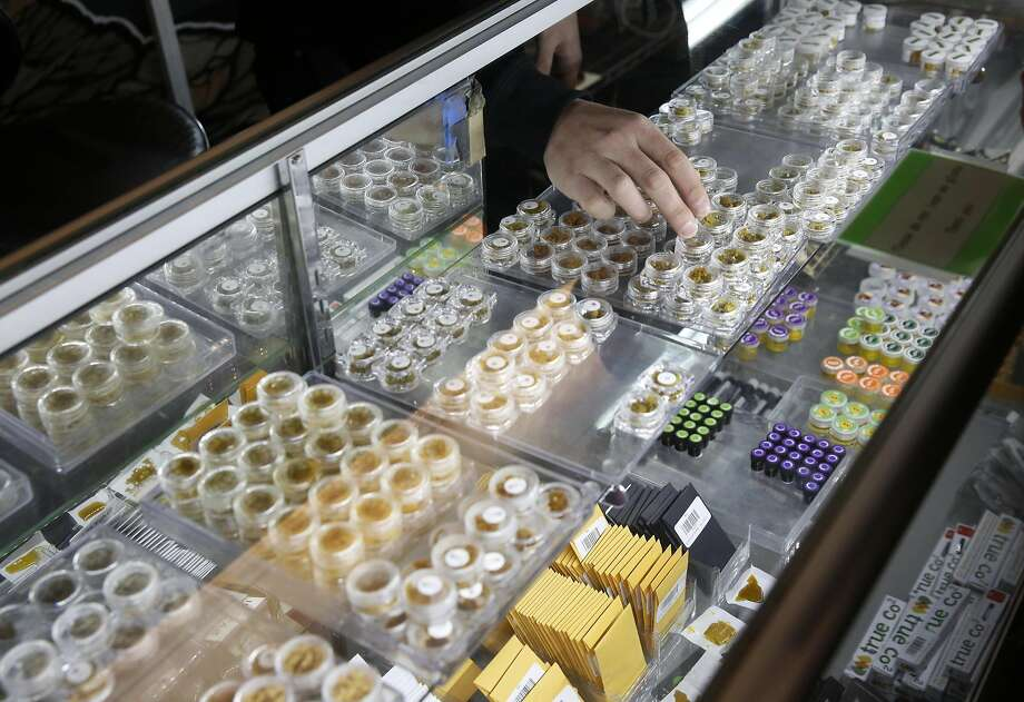 Ari Leones retrieves a product as he works behind the hash bar at Blum Oakland, a medical marijuana dispensary, March 24, 2016 in Oakland, Calif. Photo: Leah Millis, The Chronicle