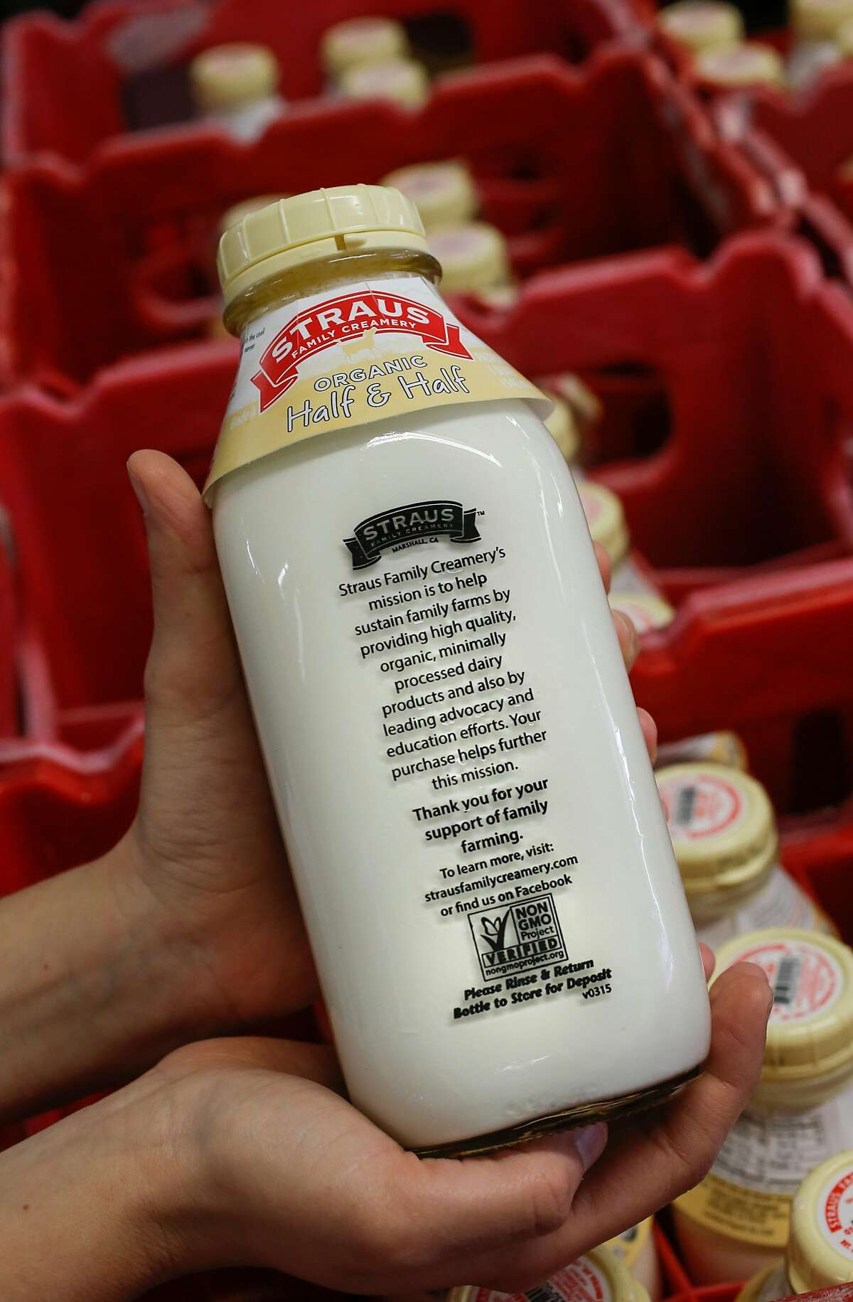 Organic non-GMO Half & Half in glass bottles carry the verified label on the back, during production at the processing plant of the organic dairy Straus Family Creamery in Marshall, California, on Thurs. March 24, 2016.