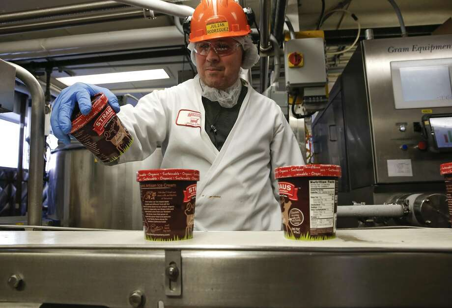 Julian Rodriguez, works the line where pints of organic non-GMO dutch chocolate ice cream are being produced at the processing plant of the organic dairy Straus Family Creamery in Marshall, California, on Thurs. March 24, 2016. Photo: Michael Macor, The Chronicle