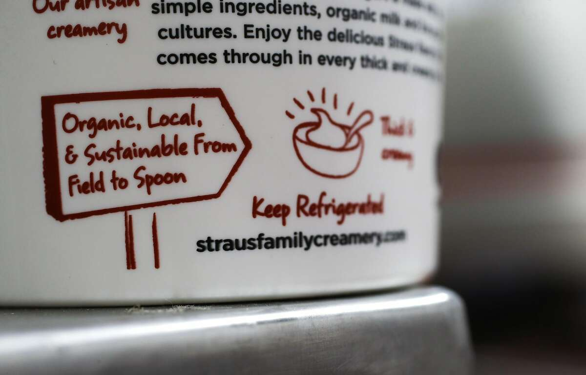 Labeling on the line of non-GMO organic greek yogurt produced at the processing plant of the organic dairy, Straus Family Creamery in Marshall, California, on Thurs. March 24, 2016.