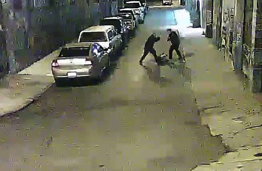 Two Alameda County Sheriff deputies are shown beating a man on a street in San Francisco's Mission District in a video screen grab provided by the San Francisco Public Defender's Office. Photo: Coutesy Of San Francsco Public D