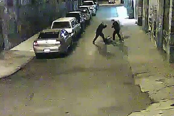 Two Alameda County Sheriff deputies are shown beating a man on a street in San Francisco's Mission District in a video screen grab provided by the San Francisco Public Defender's Office.