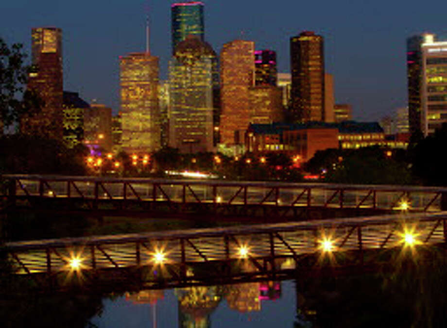 Downtown Houston at dusk looking east over the Buffalo Bayou, Tuesday, Oct. 13, 2015, in Houston. ( Mark Mulligan / Houston Chronicle ) Photo: Mark Mulligan, Staff / © 2015 Houston Chronicle