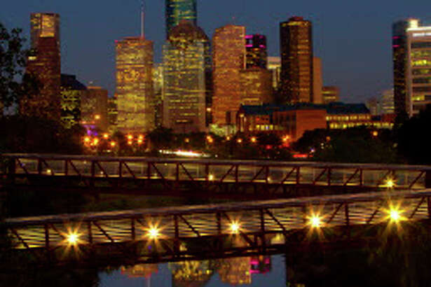Downtown Houston at dusk looking east over the Buffalo Bayou, Tuesday, Oct. 13, 2015, in Houston. ( Mark Mulligan / Houston Chronicle )