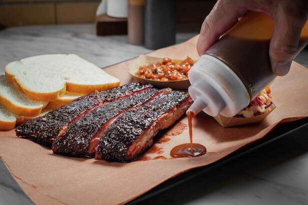 A display of barbecue at Killen's Barbecue in Pearland. Killen's BBQ's pork ribs, beans and coleslaw. Photographed, Thursday, July 16, 2015, in Pearland. ( Nick de la Torre )