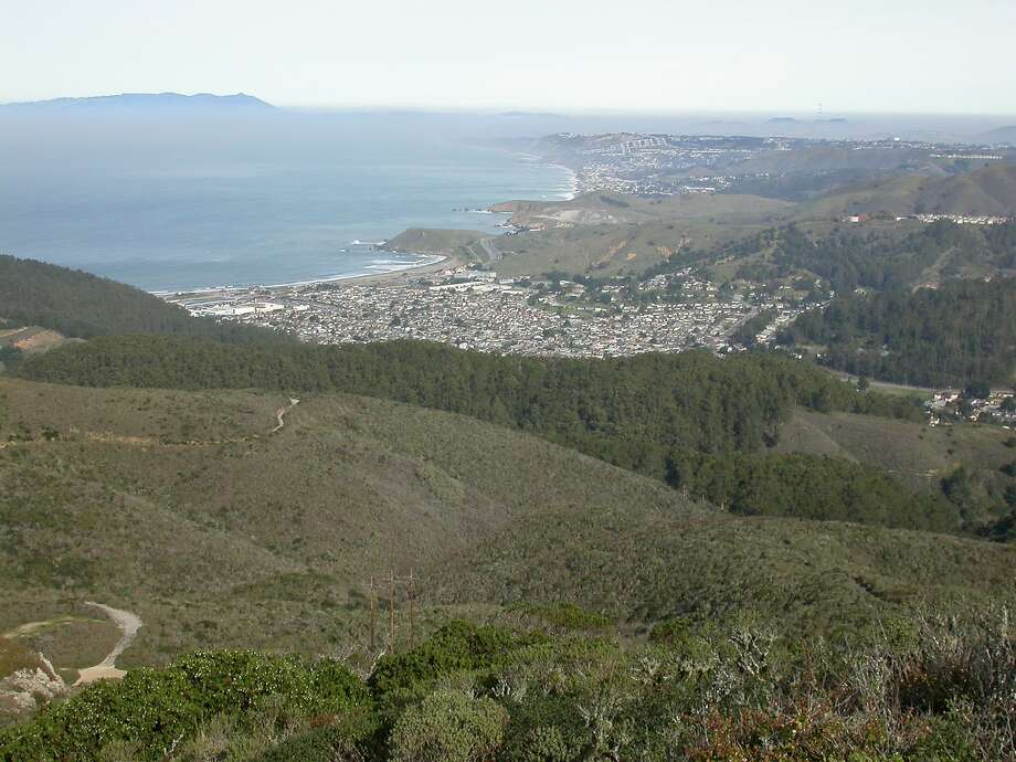 The Montara Mountain Trail, which towers over Linda Mar, Pacifica, Mori Point, Mussel Rock and beyond, will reopen Nov. 1 after being closed for renovation and vegetation management. Photo: Tom Stienstra / The Chronicle 2013