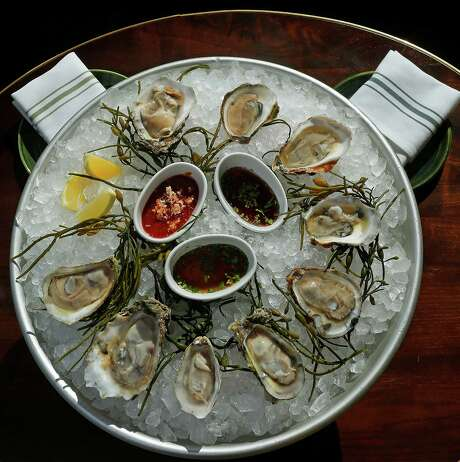 A platter of fresh oysters at the restaurant State of Grace Photo: Mark Mulligan, Staff / © 2016 Houston Chronicle