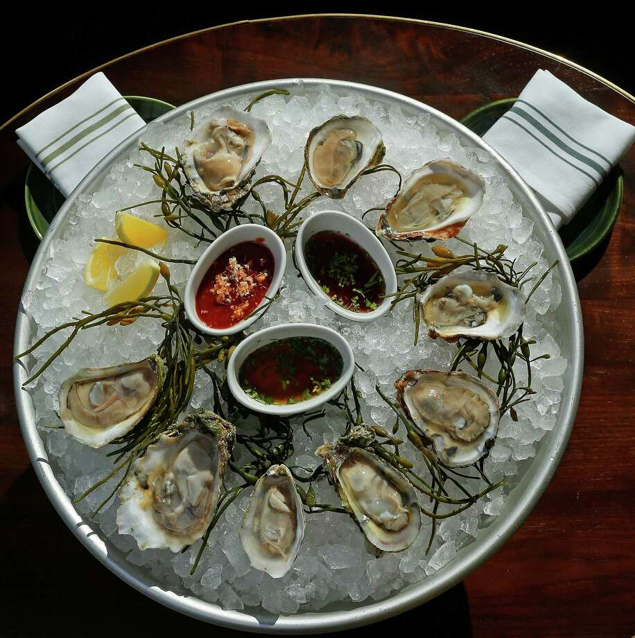 A platter of fresh oysters at the restaurant State of Grace. The restaurant is among the south's best new oyster bars according to Garden & Gun magazine. Photo: Mark Mulligan, Staff / © 2016 Houston Chronicle