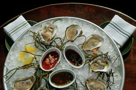 A platter of fresh oysters at the restaurant State of Grace, Wednesday, Feb. 10, 2016, in Houston. ( Mark Mulligan / Houston Chronicle )
