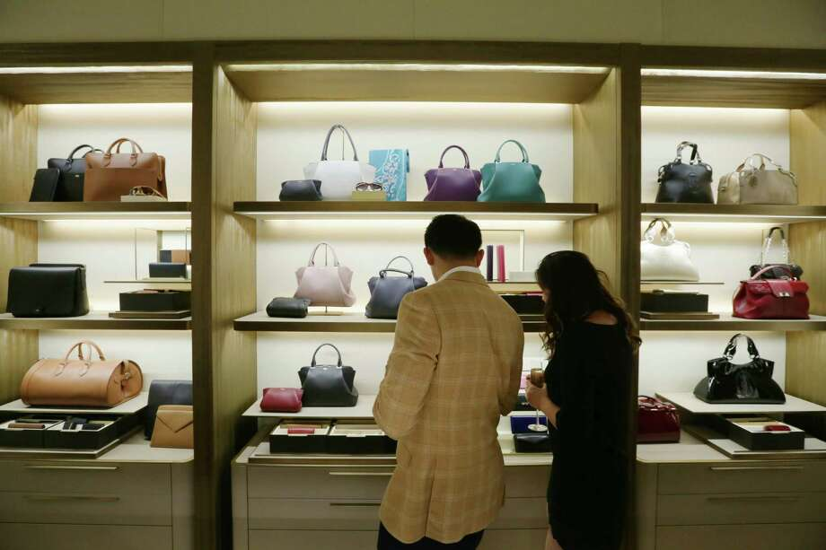 Customers shop at the Cartier store in River Oaks District. Photo: Jon Shapley, Staff / © 2015  Houston Chronicle