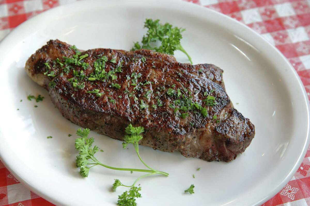 Rib-eye from Texas beef, grilled over a mesquite and charcoal grill.