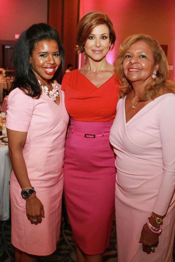 Claire Cormier Thielke, Dominique Sachse and Yvonne Cormier donned pink and red at the Razzle Dazzle luncheon. Photo: Gary Fountain, For The Chronicle / Copyright 2015 Gary Fountain