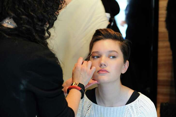 Makeup artist Deanna Melluso perfects the brow on a model backstage during New York Fashion Week.
