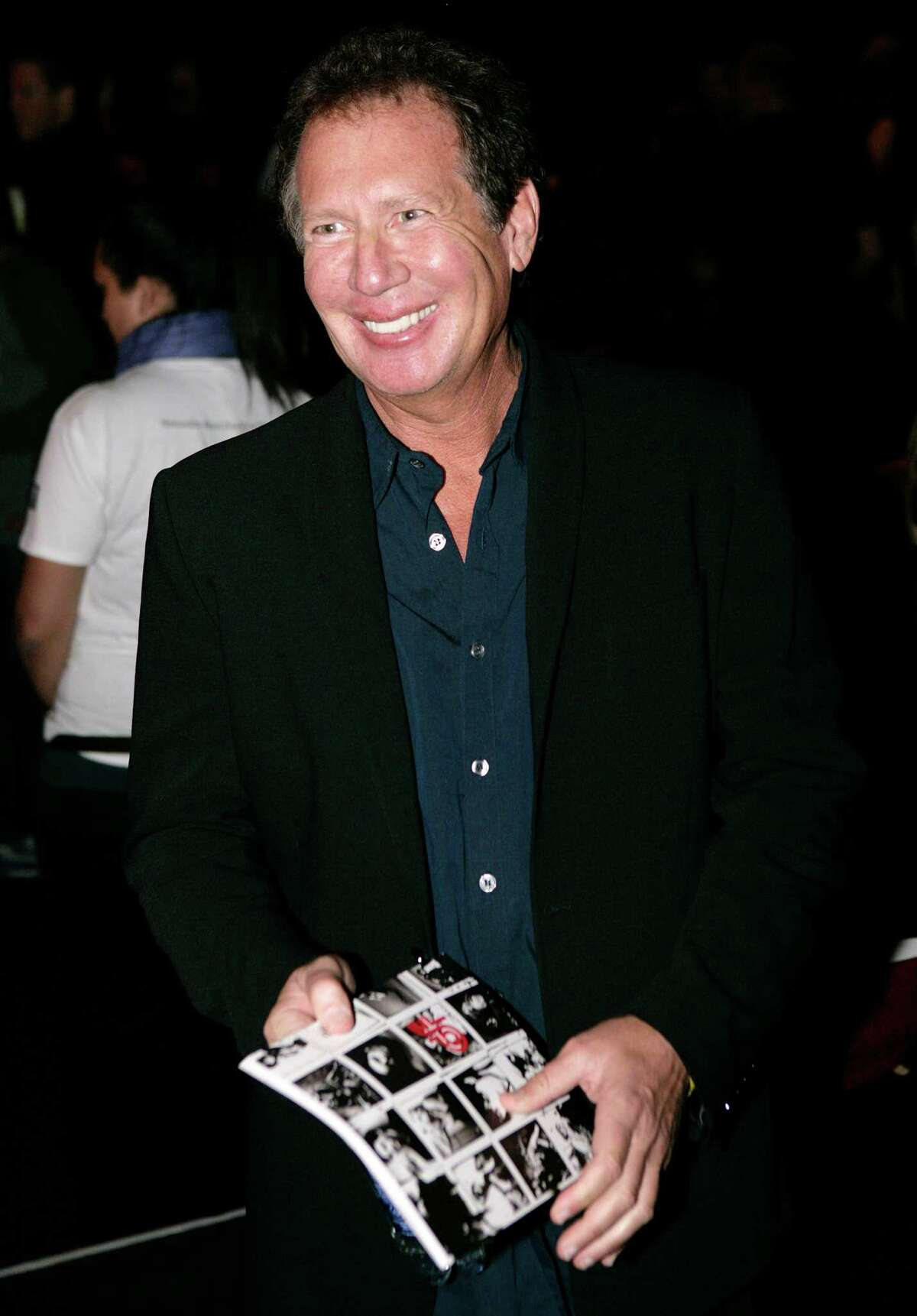 In this Oct. 17, 2006 file photo, actor Gary Shandling poses for photographers before the Jennifer Nicholson fashion show during Mercedes Benz Fashion Week in Culver City, Calif.