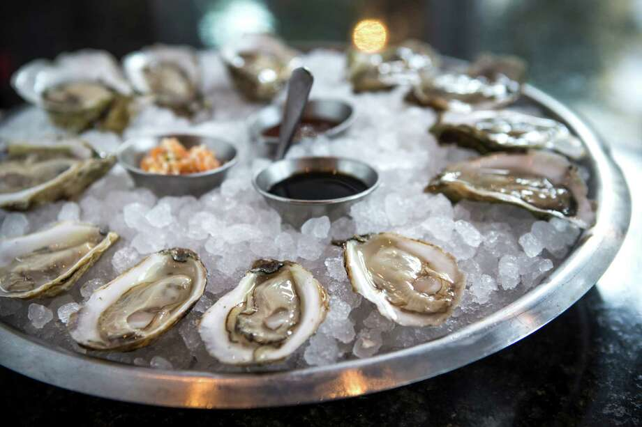 Raw Oysters on the Half Shell with spicy ponzu sauce, escabeche, mignonette and horseradish cocktail sauce at Holley's Seafood Restaurant & Oyster Bar Photo: Brett Coomer, Staff / © 2014 Houston Chronicle