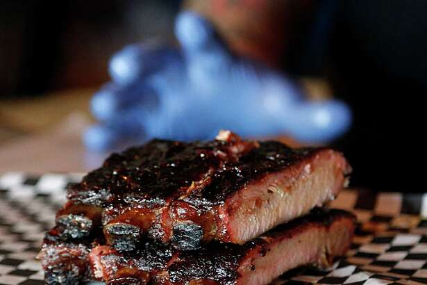 Pappa Charlie's Barbecue east of downtown does pork ribs right.